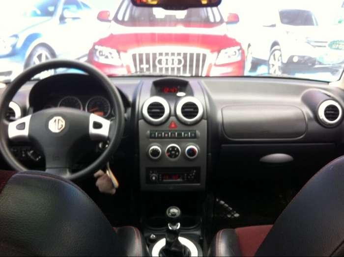 转让10年2月的名爵G3_1.4手动,蓝色,一手精品私家车, 配置有:4个安全气囊,发动机电子防盗,车内中控锁,遥控钥匙,ABS/EBD,电动天窗,铝合金轮毂,真皮方向盘,倒车雷达,电动后视镜,电动真皮座椅,电动车窗,车窗防夹手功能, 动调节,遮阳板化妆镜,自动恒温空调,外观时尚大气,无事故,无碰撞,该车手续齐全,,才跑2万多公里,定时4S店保养,车况极品,承诺全车无任何大小事故,原装漆水,内外成色崭新、双电动真皮座椅带记忆功能,铝合金轮毂,自动恒温空调、、自动头灯、感应雨刮、后窗电动遮阳帘 ,电动防旋目